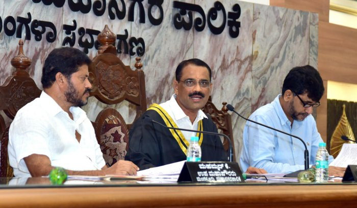 Mayor Bhaskar K chairs the Mangaluru City Corporation meeting on Thursday. Deputy Mayor Muhammed K and Commissioner B A Muhammed Nazir look on.