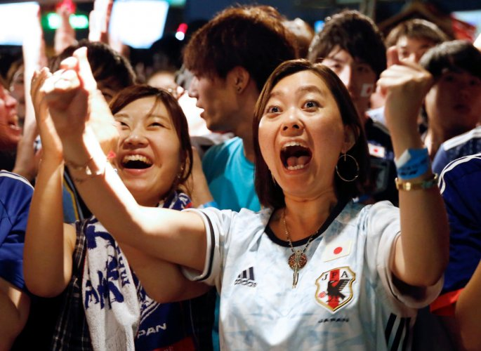 THRILLED: Japanese fans react as they watch a broadcast of their country's World Cup Group H game against Poland. Reuters
