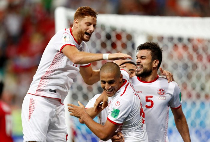 MEMORABLE MOMENT: Tunisia's Wahbi Khazri (centre) is mobbed by his team-mates after scoring the winner against Panama on Thursday. REUTERS