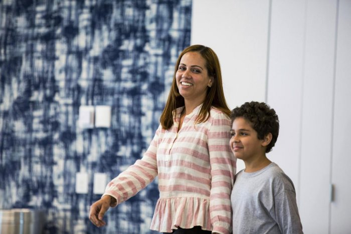 Lidia Karine Souza and her son Diogo De Olivera Filho enter a press conference at the Mayer Brown law firm during a news conference after Diogo was reunited with his mother. AP/PTI file photo