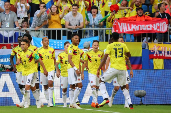 Colombia's Yerry Mina celebrates scoring their first goal with teammates REUTERS