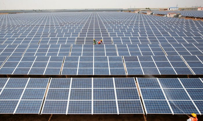 India will auction 40 GW of renewable energy projects comprising 30 GW solar and 10 GW wind every year for the next 10 years till 2028. Reuters Photo