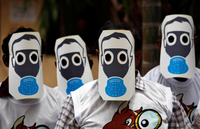 People protest against pollution by wearing cutouts of gas masks on World Environment Day in Mumbai, India, June 5, 2018. Reuters photo for representation.