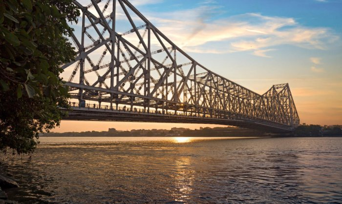 Howrah Bridge is a cantilever bridge built on the river Hooghly connecting the city of Kolkata with the Howrah district.