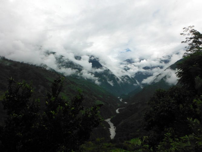 Clouds start to fill the valleys in the lower Annapurna Himalayas during monsoon.