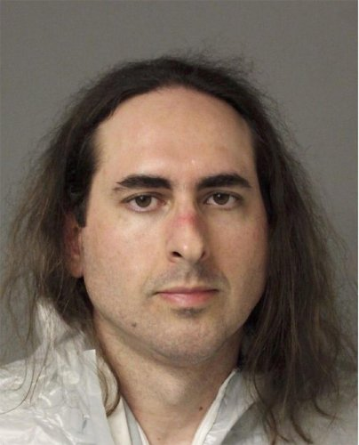 In this June 28, 2018, photo released by the Anne Arundel Police, Jarrod Warren Ramos poses for a photo, in Annapolis, Md. First-degree murder charges were filed Friday against Ramos who police said targeted Maryland's capital newspaper, shooting his way