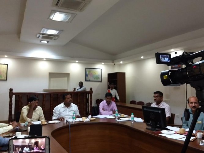 Urban Development and Housing Minister U T Khader chairs meeting at Mangaluru deputy commissioner's office to review progress of national highways on Saturday. DH Photo
