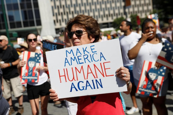 "A demonstrator holding a sign participates in ""Keep Families Together"" march to protest Trump administration's immigration policy in Manhattan, New York. (Reuters Photo)"