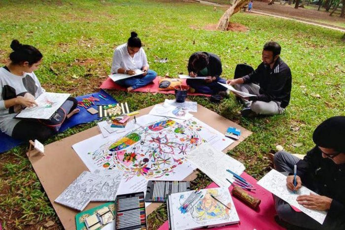 Participants immersed in colouring at the Sunday Colouring session in Cubbon Park.