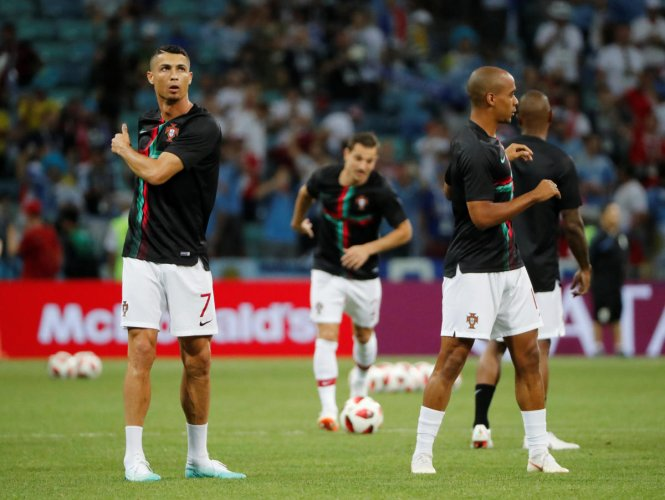 Portugal's Cristiano Ronaldo and Joao Mario during the warm up before the match REUTERS