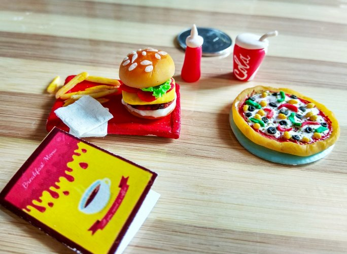 Umagayathri makes miniature food models of popular dishes out of air-dry clay.