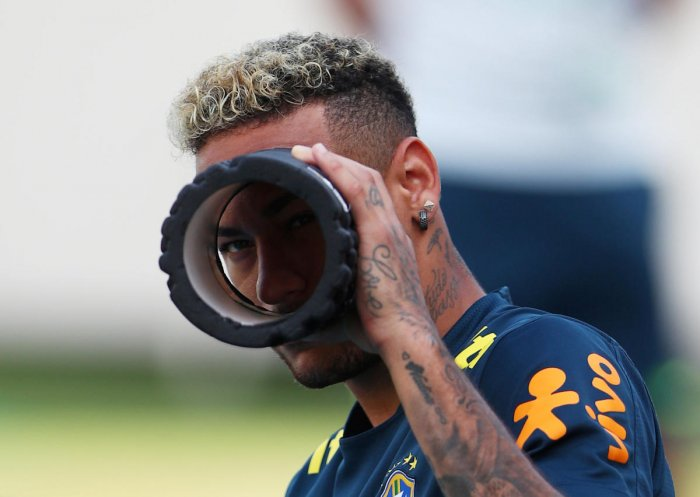 SEEKING THE LARGER PICTURE: Brazil superstar Neymar in a playful mood during a practice session ahead of the mouth-watering clash against Mexico. REUTERS