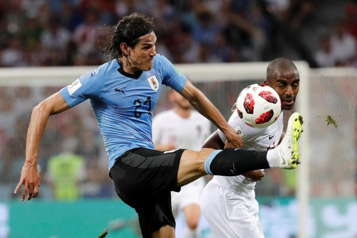 Uruguay's Edinson Cavani in action with Portugal's Ricardo Pereira. REUTERS.