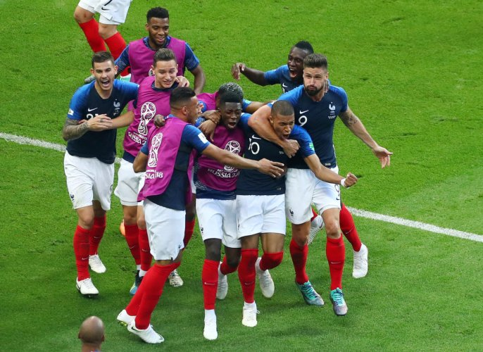 Kylian Mbappe celebrates scoring their fourth goal with Olivier Giroud and team mates. Reuters