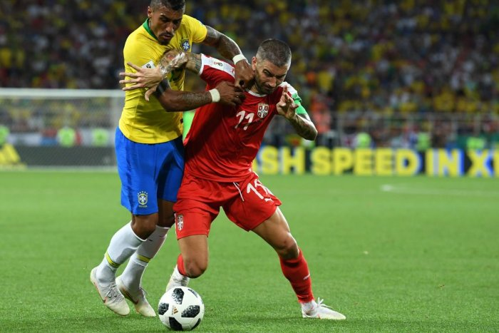 Brazil's midfielder Paulinho (L) fights for the ball with Serbia's defender Aleksandar Kolarov during the Russia 2018 World Cup Group E football match between Serbia and Brazil at the Spartak Stadium in Moscow. AFP Photo