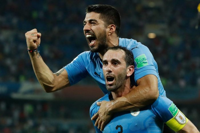 HERE WE COME! A combination of deadly strikers like Luis Suarez (back) and robust defenders like Diego Godin has turned Uruguay into a strong force. AFP