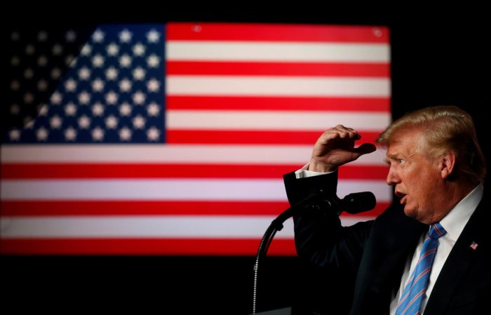 """U.S. President Donald Trump delivers remarks at a """"Salute to Service"""" dinner held in honor of the nation's military at The Greenbrier in White Sulphur Springs, West Virginia, U.S., July 3, 2018. REUTERS"""
