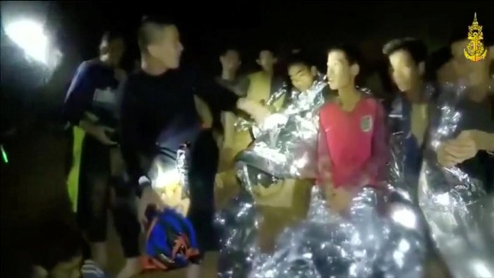 Boys from the under-16 soccer team trapped inside Tham Luang cave greet members of the Thai rescue team in Chiang Rai, Thailand, in this still image taken from a July 3, 2018 video by Thai Navy Seal. Thai Navy Seal/Handout via REUTERS