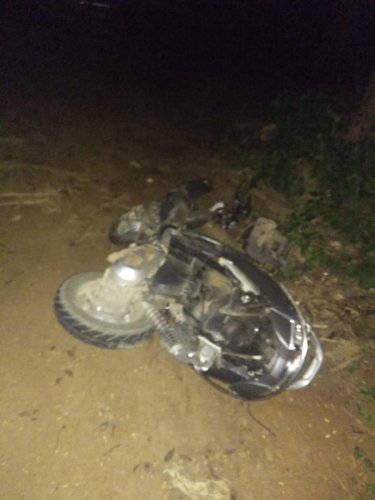 The bike that crashed head-on into a car killing the three riders in Gubbi, Tumakuru district, on Tuesday night. DH photo.