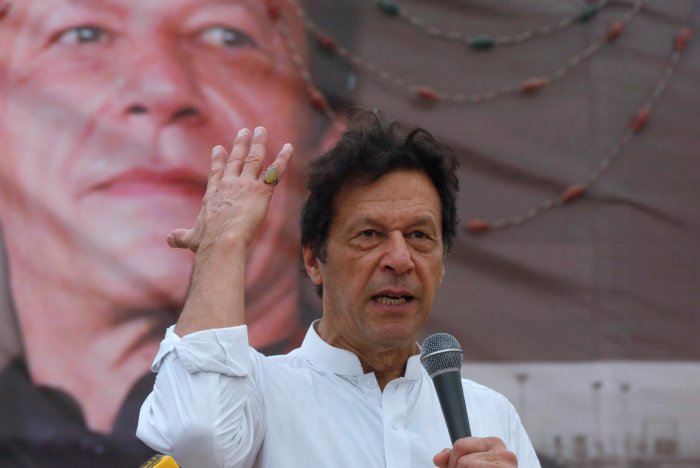 Imran Khan, chairman of the Pakistan Tehreek-e-Insaf (PTI), gestures while addressing his supporters during a campaign meeting ahead of general elections in Karachi, Pakistan, July 4, 2018. REUTERS
