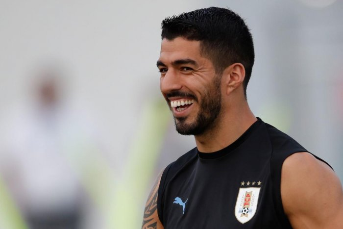 Infamous for his antics, Luis Suarez has mellowed down considerably at this World Cup, donning the role of a mentor for juniors in the Uruguay team. AFP