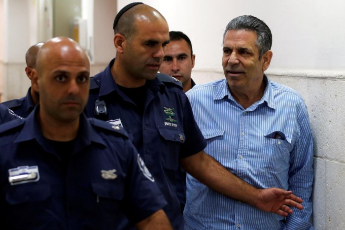 Gonen Segev, a former Israeli cabinet minister indicted on suspicion of spying for Iran, is escorted by prison guards as he arrives at court in Jerusalem. REUTERS Photo