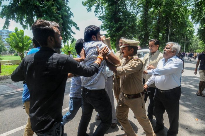 Lucknow: Protestors at Lucknow University being detained by police as Vice Chancellor SP Singh (R) looks on, in Lucknow on Wednesday, July 04, 2018. (PTI Photo/Nand Kumar)