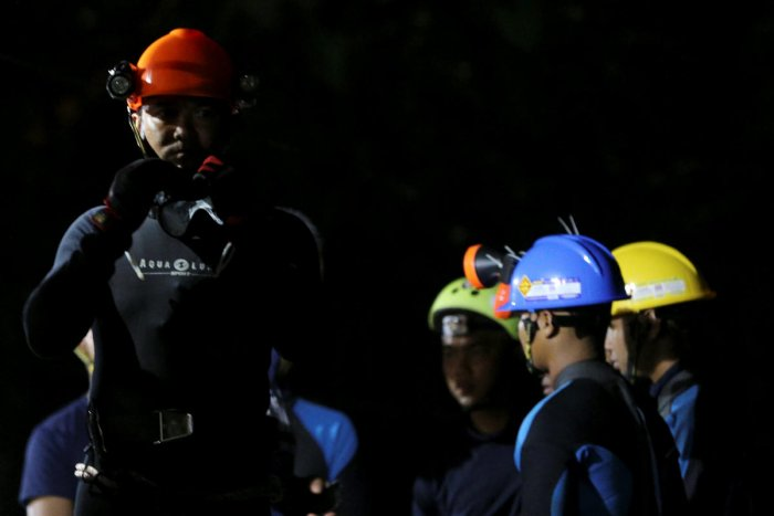 Thai divers gather before they enter to the Tham Luang cave, where 12 boys and their soccer coach are trapped, in the northern province of Chiang Rai, Thailand, July 6, 2018. REUTERS