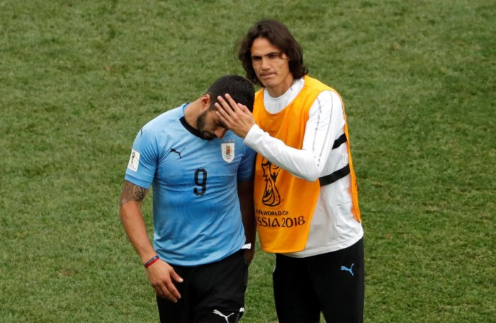 Uruguay's Luis Suarez and Edinson Cavani look dejected after their World Cup quarter-final against France. (Reuters Photo)