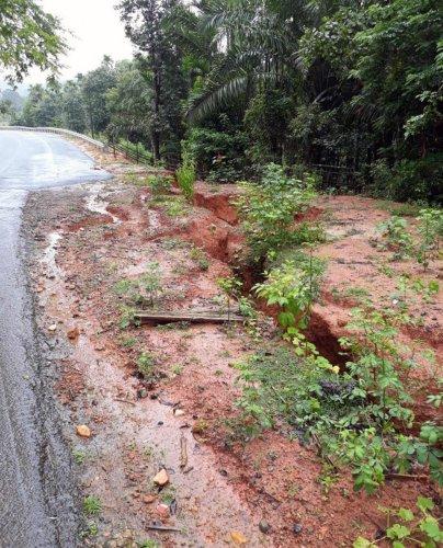 A road is partially damaged at Addagadde in Sringeri.