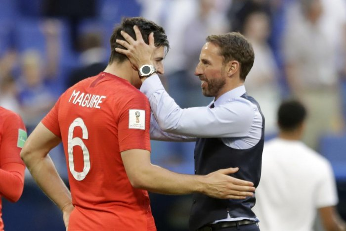 England head coach Gareth Southgate, right, celebrates the victory of his team over Sweden with England's Harry Maguire during the quarterfinal match. AP/PTI photo