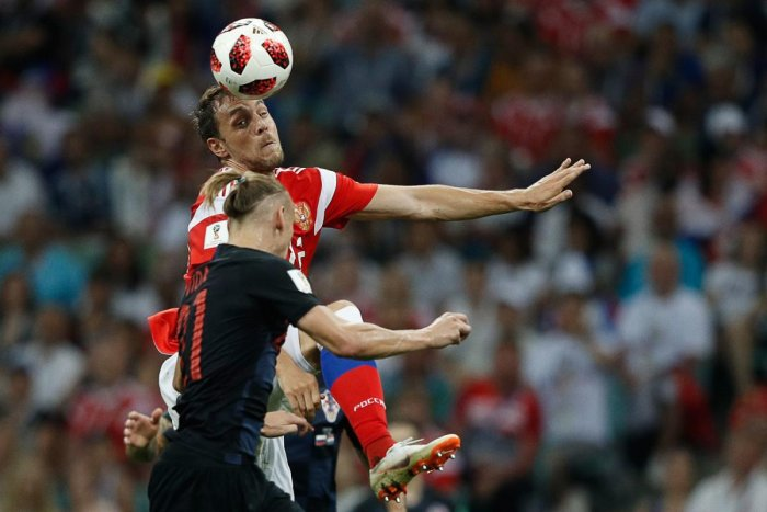 Russia's forward Artem Dzyuba (back) vies for the header with Croatia's defender Domagoj Vida during the Russia 2018 World Cup quarter-final football match between Russia and Croatia at the Fisht Stadium in Sochi on July 7, 2018. AFP PHOTO