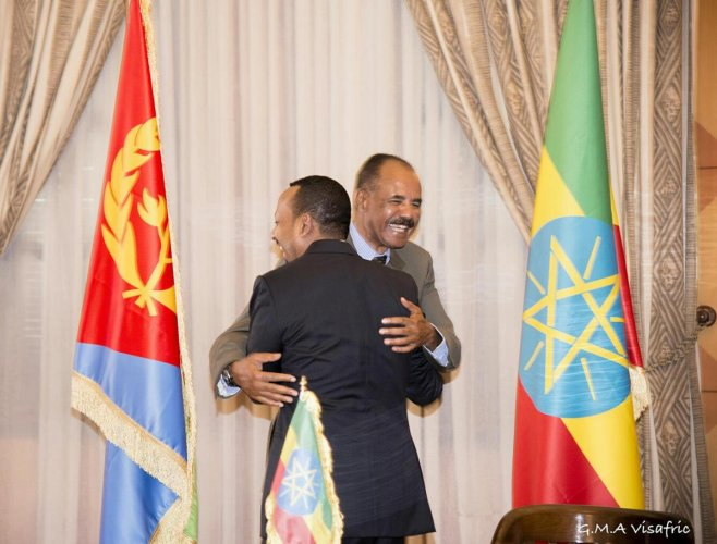 Ethiopia's Prime Minister Abiy Ahmed and Eritrean President Isaias Afwerk embrace at the declaration signing in Asmara, Eritrea July 9, 2018 in this photo obtained from social media on July 10, 2018. (GHIDEON MUSA ARON VISAFRIC/via REUTERS)