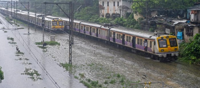 """""""Every year during monsoons tracks get submerged in water in lowlying areas. Why can not the Railways identify such spots and elevate the tracks?"""" Justice Kulkarni asked."""