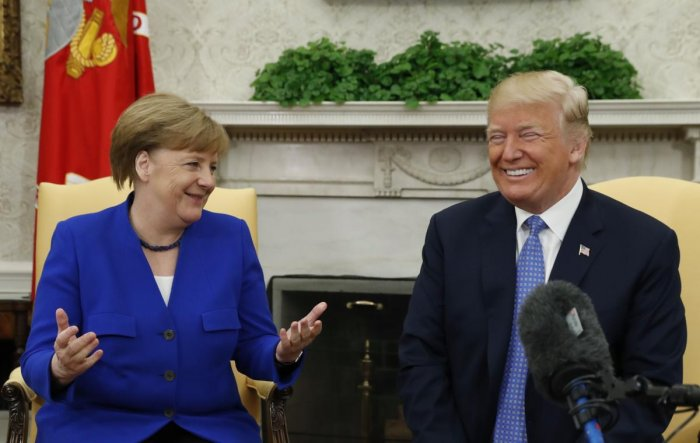 US President Donald Trump and  German Chancellor Angela Merkel in the White House Oval Office in Washington. Reuters File Photo