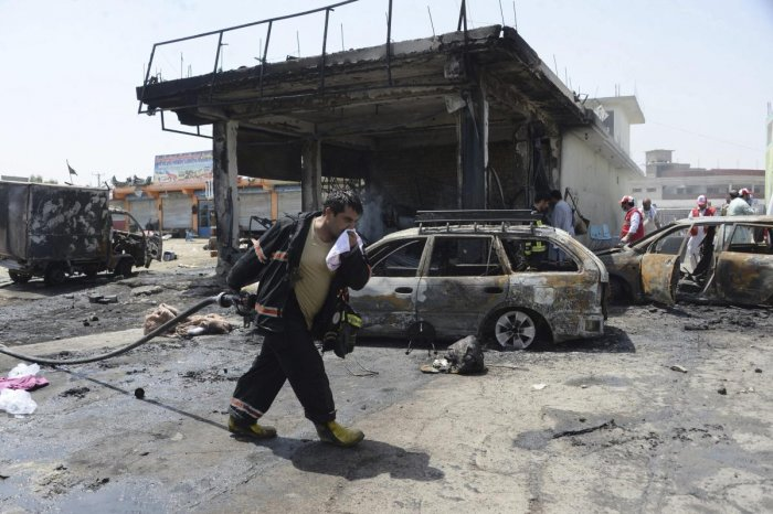 Firefighters work at the site of a deadly suicide attack in Jalalabad, the capital of Nangarhar province, Afghanistan, Tuesday, July 10, 2018. (AP/ PTI)