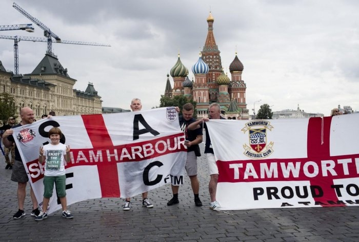 England soccer fans pose for a photo with their club banners in Red Square during the 2018 soccer World Cup in Moscow, Russia, Tuesday, July 10, 2018. (AP/PTI)