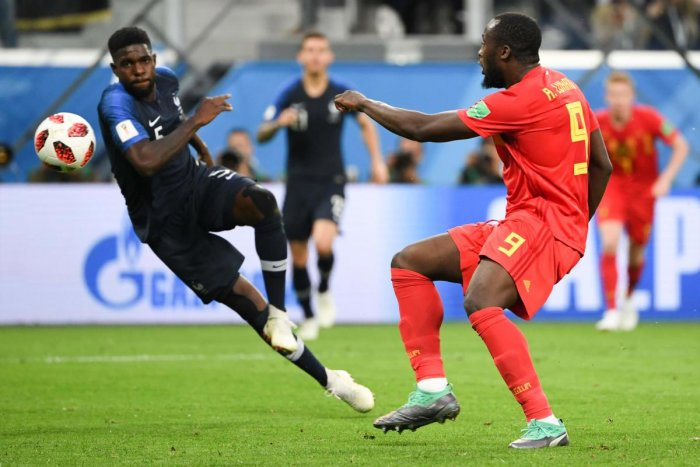 France's defender Samuel Umtiti (L) and Belgium's forward Romelu Lukaku vie for the ball during the Russia 2018 World Cup semi-final football match between France and Belgium at the Saint Petersburg Stadium in Saint Petersburg on July 10, 2018. / AFP PHOT