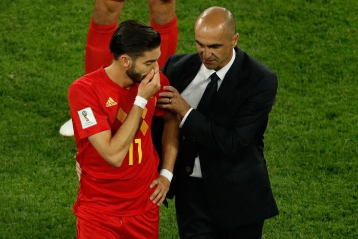 SAD SCENES: Belgium's midfielder Yannick Ferreira-Carrasco (left) is consoled by coach Roberto Martinez after they lost to France in the World Cup semifinal on Tuesday. (AFP Photo)
