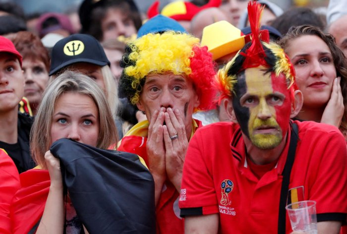 Belgium fans react as they watch the broadcast of the World Cup semi-final match between France and Belgium in the fan zone. (REUTERS/Yves Herman)
