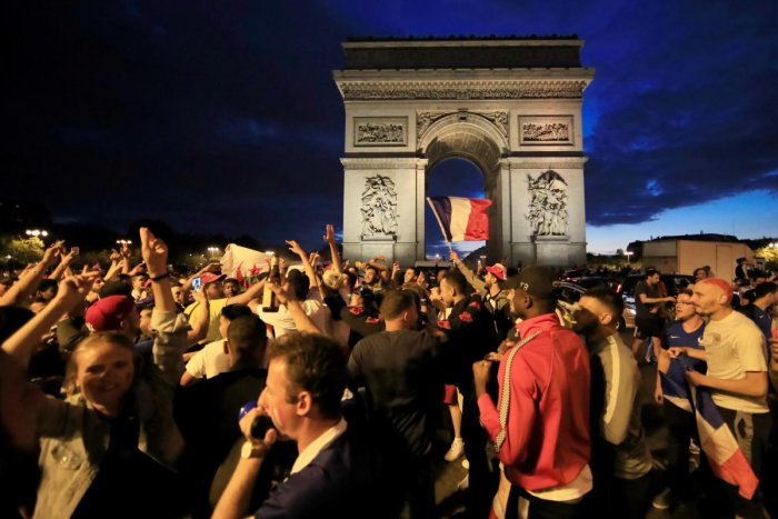 France fans react on the Champs-Elysees after defeating Belgium in their World Cup semi-final match. (REUTERS/Gonzalo Fuentes)
