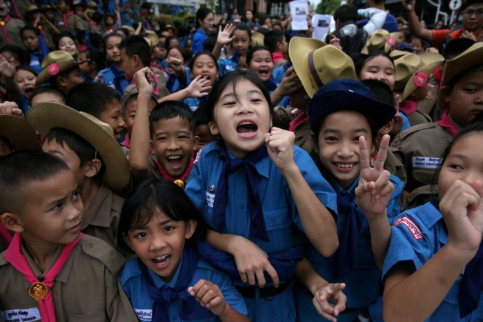 Students celebrate in front of Chiang Rai Prachanukroh hospital, where the 12 soccer players and their coach rescued from the Tham Luang cave complex are being treated, in the northern province of Chiang Rai, Thailand, July 11, 2018. (REUTERS/Athit Perawo