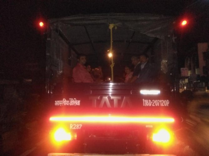 Train travellers in a truck after Army helped their evacuation due to rain in Mumbai. (DH Photo)