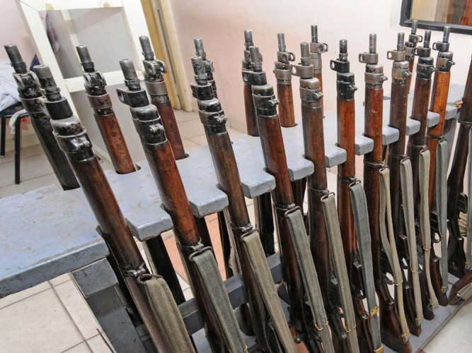 A woman police sub-inspector and four constables attached to the Kumaraswamy Layout police station have been suspended in connection with a case of the missing rifle from the station's strong room recently.