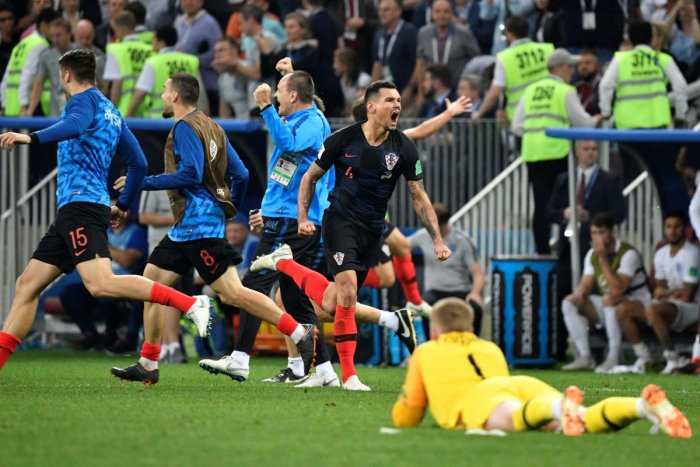 Croatia's players celebrate their victory at the end of the Russia 2018 World Cup semi-final football match between Croatia and England at the Luzhniki Stadium in Moscow on July 11, 2018. / AFP PHOTO
