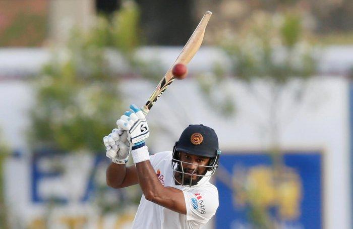 Sri Lanka's Dimuth Karunaratne plays a shot. REUTERS
