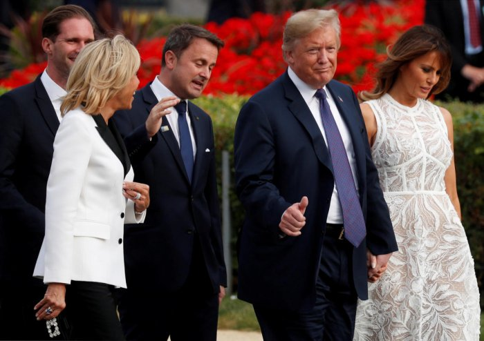 President Donald Trump with U.S. first lady Melania Trump, Luxembourg's Prime Minister Xavier Bettel with his spouse Gauthier Destenay and France's first lady Brigitte Macron walk during the NATO Summit. Reuters photo.