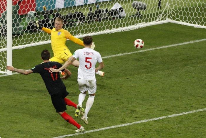 PREDATORIAL FINISH: Croatia's Mario Mandzukic (left) scores the winner past England's Jordan Pickford in the semifinal on Wednesday. AP/PTI