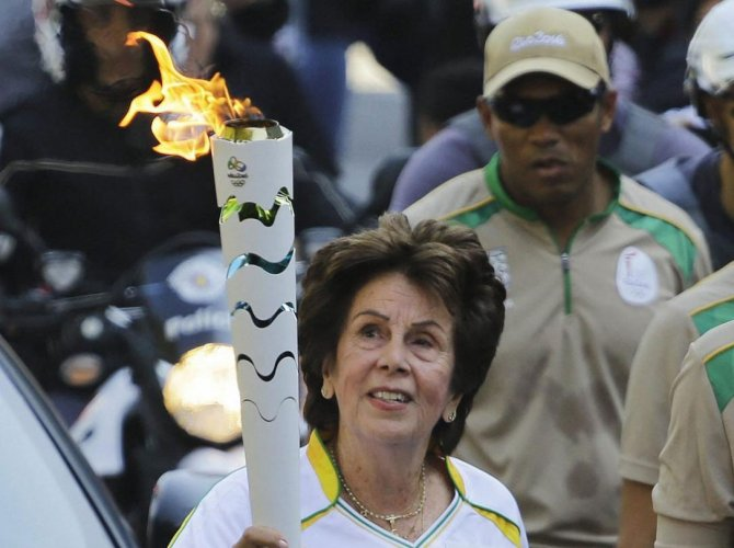 Former No. 1-ranked tennis player Maria Esther Bueno carries the Rio 2016 Olympic torch during the torch relay in Sao Paulo, Brazil. AP/PTI file photo.