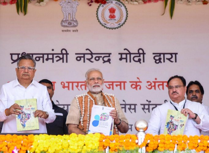 Prime Minister, Narendra Modi during the inauguration of the Health and Wellness Centre to mark the launch of Ayushman Bharat, in Bijapur, Chhatisgarh on Saturday. Chief Minister of Chhattisgarh, Raman Singh and the Union Minister for Health & Family